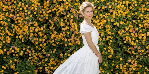 Yellow, Petal, Dress, Flower, People in nature, Formal wear, Gown, Wedding dress, Bridal clothing, Shrub,