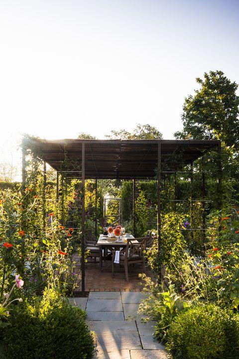 Garden, Botany, Pergola, Shrub, Outdoor table, Shade, Outdoor furniture, Botanical garden, Gazebo, Patio,