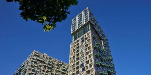 Blue, Daytime, Architecture, Tower block, Green, Property, Facade, Urban area, Metropolitan area, Condominium,