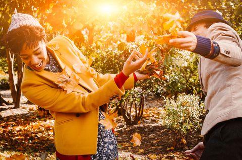 Hand, Happy, Leaf, People in nature, Orange, Tradition, Ceremony, Autumn, Deciduous, Gesture,