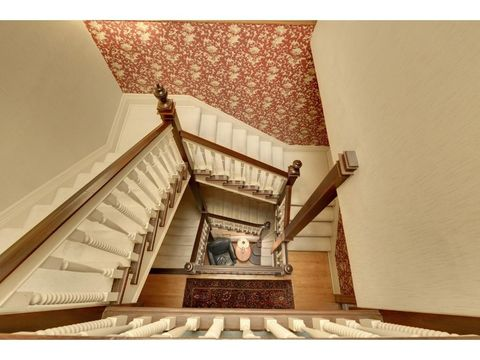 Stairs, Property, Ceiling, House, Molding, Beige, Tints and shades, Handrail, Symmetry, Plaster,