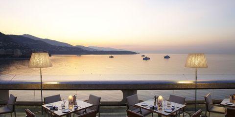 Table, Furniture, Restaurant, Horizon, Outdoor furniture, Chair, Outdoor table, Dusk, Coffee table, Sea,