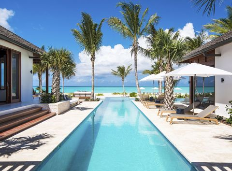 "<p>The <a href=""http://invillas.com/villa/caribbean/hawksbill-grace-bay/"" target=""_blank"">five-plus-acre estate</a> sits on the residential end of Providenciales's world famous Grace Bay, meaning your section of sand will be practically untouched. ""It's not so much about the scene here but the beaches and relaxing with family and friends,"" says Blair. The 10-bedroom home, which accommodates 22, has a hot tub, tennis court, and game room. Snorkeling excursions to an incredible natural reef can be arranged. <em data-redactor-tag=""em"" data-verified=""redactor""><strong data-redactor-tag=""strong"">From $68,250 per week</strong></em></p>"