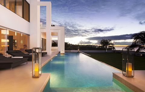 "<p>It's not hard to see why Blair calls <a href=""http://invillas.com/villa/caribbean/the-beach-house-meads-bay/"" target=""_blank"">this eight-bedroom Meads Bay villa</a> ""ideal for people who like to be in the middle of everything,"" given Justin Bieber was a guest last Christmas. Passersby (there aren't many) may stop to marvel at the modern façade, but don't worry—they can't see past it. Favorites Blanchards and Malliouhana are a short walk, though the house comes with a chef, theater, game room, and tennis court. <em data-redactor-tag=""em""><strong data-redactor-tag=""strong"">From $75,000 per week</strong></em></p>"