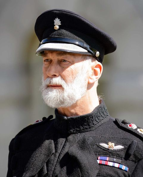 Cap, Chin, Collar, Uniform, Facial hair, Headgear, Costume accessory, Peaked cap, Beard, Costume,