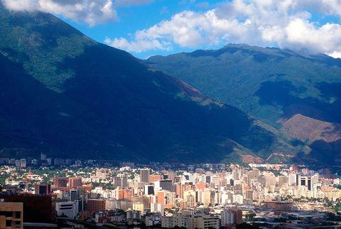 Sky, Mountainous landforms, Mountain, Urban area, Metropolitan area, Blue, City, Mountain range, Town, Cloud,
