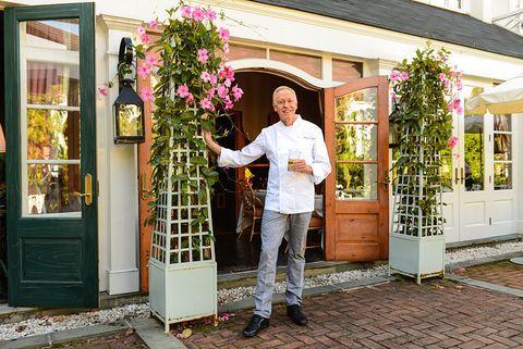 Door, Real estate, House, Home door, Fixture, Jacket, Street fashion, Floristry, Gate, Flower Arranging,