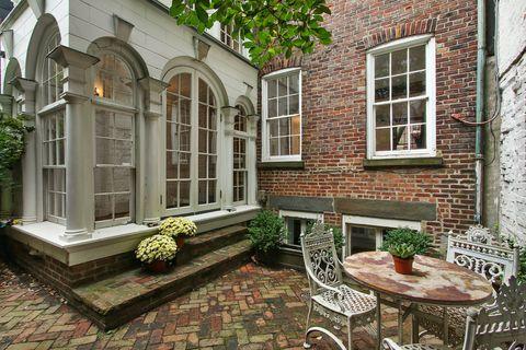 Window, Flowerpot, Table, House, Real estate, Outdoor furniture, Outdoor table, Brick, Door, Courtyard,