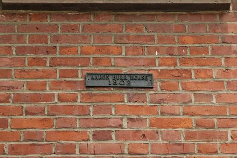 Brick, Brickwork, Wall, Property, Text, Photograph, Line, Colorfulness, Rectangle, Parallel,