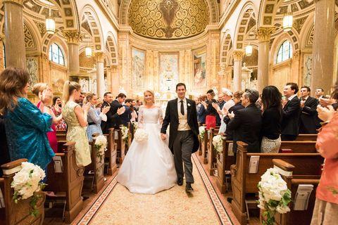 Event, Bridal clothing, Photograph, Dress, Suit, Petal, Bride, Coat, Formal wear, Tradition,