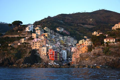 Mountainous landforms, Residential area, Building, House, Hill, Town, Mountain, Bank, Coast, Terrain,