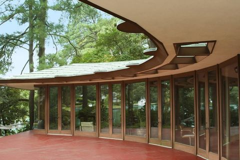 Wood, Property, Architecture, Hardwood, Real estate, Wood stain, Shade, Glass, Fixture, Composite material,