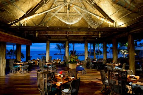 "<p>Take in the enchanting sights of Ko Olina Beach or watch the sun set as you dine al fresco&nbsp;at Aulani.&nbsp;The restaurant is named after the 'AMA'AMA, a local mullet fish—and it's inspired by the fishing settlements along the leeward coast of O'ahu that date back to the 12th century.&nbsp;The restaurant, which is designed to resemble a beachside house, features a thatched roof, mosaic designs, a fountain, and a reflecting pool.<br></p><p><a href=""https://resorts.disney.go.com/aulani-hawaii-resort/dining/table-service/ama-ama-restaurant/"" target=""_blank"" data-tracking-id=""recirc-text-link"">resorts.disney.go.com</a></p>"
