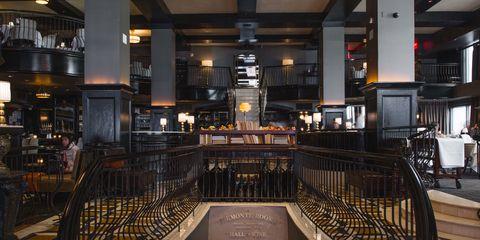Ceiling, Beam, Handrail, Light fixture, Stairs, Symmetry, Hall, Column,