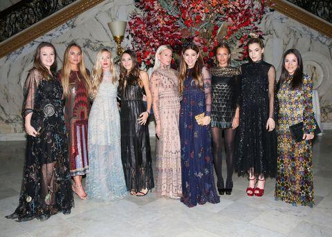 Social group, Textile, Dress, Fashion, One-piece garment, Street fashion, Waist, Maroon, Tradition, Day dress,
