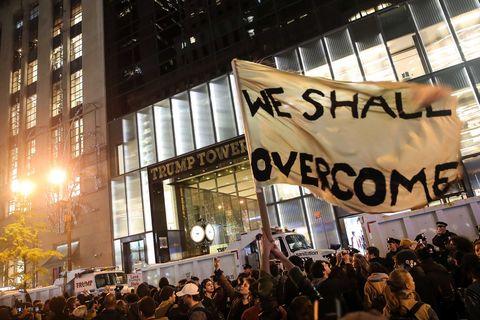 Crowd, Metropolitan area, Protest, Metropolis, Public event, Banner, Downtown, Rebellion, Advertising, Commercial building,