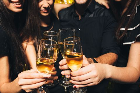 Drinking At A Party With Champagne Glasses