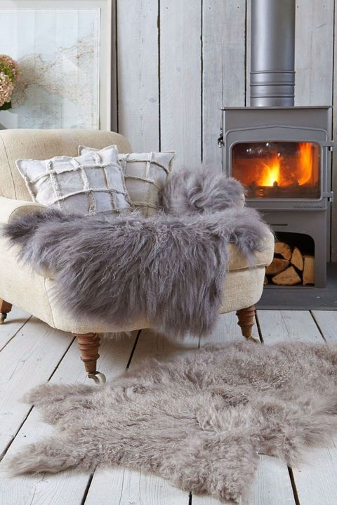 Hearth, Textile, Floor, Natural material, Heat, Grey, Fire screen, Feather, Fur, Beige,
