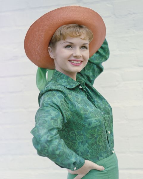 Green, Sleeve, Hat, Facial expression, Costume accessory, Tooth, Sun hat, Laugh, Button, Belt,