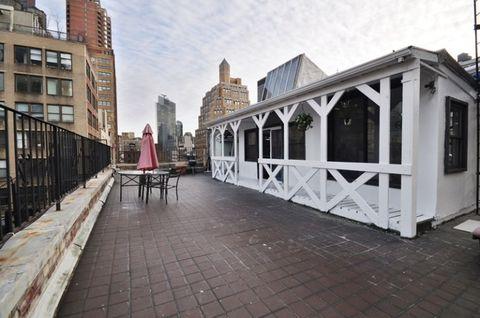 Building, Apartment, Roof, Mixed-use, Door, Outdoor table, Urban design, Outdoor furniture, Balcony, Outdoor structure,