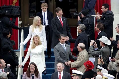 Hair, Face, Coat, Suit, Mammal, Formal wear, Tie, Dress, Ceremony, Blazer,