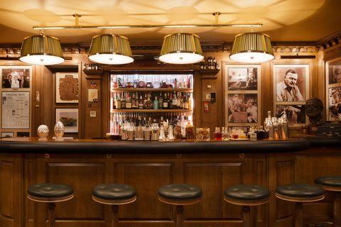 Lighting, Bottle, Interior design, Ceiling, Light fixture, Wood stain, Drink, Barware, Alcoholic beverage, Distilled beverage,