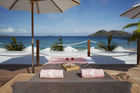 "<p> A recent makeover&nbsp;left the legendarily luxe Cheval Blanc St-Barth Isle de France, now under the LVMH umbrella, even more glittering. Tucked in an idyllic curve of Flamands beach and surrounded by a grove of palm trees, it's the place to see the likes of Jay Z and Beyoncé, Marc Jacobs, and Anthony Kiedis—or, if you prefer, no one at all, with plenty of romantic, sandy nooks to hide away and drink rosé in peace. And with a rumored upcoming purchase of nearby Taiwana, which itself underwent a recent redesign, the Cheval Blanc brand promises even more potential for perfection.&nbsp;</p><p><i data-redactor-tag=""i""><a href=""http://stbarthisledefrance.chevalblanc.com/"" target=""_blank"" data-tracking-id=""recirc-text-link"">stbarthisledefrance.chevalblanc.com</a></i><span class=""redactor-invisible-space"" data-verified=""redactor"" data-redactor-tag=""span"" data-redactor-class=""redactor-invisible-space""><a href=""http://stbarthisledefrance.chevalblanc.com/""></a></span></p>"