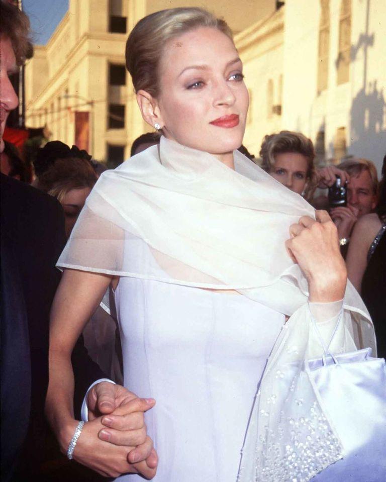 Uma Thurman in a lilac Prada gown and chiffon wrap.