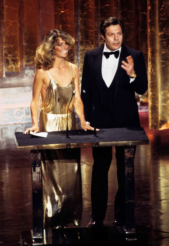 Farrah Fawcett in a gold Stephen Burrows gown.