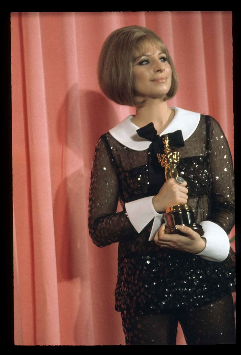 Barbra Streisand wears a gown designed by Arnold Scaasi.