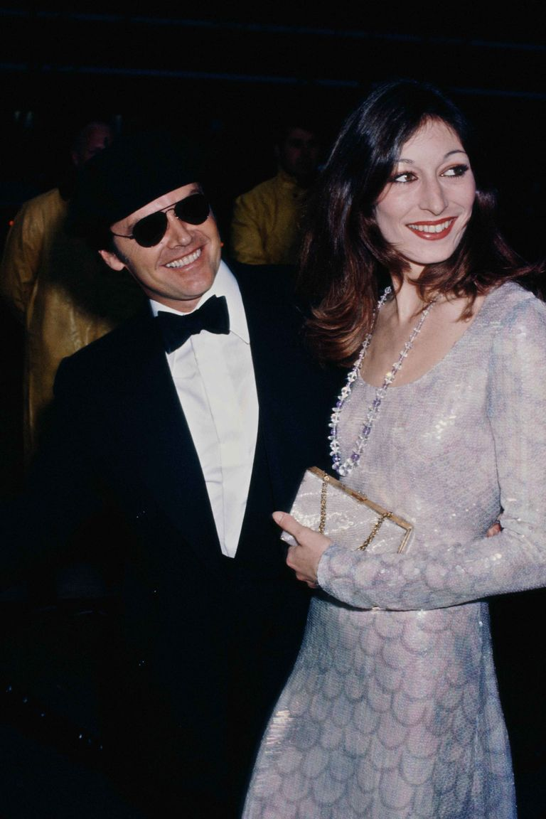 Anjelica Huston in a long-sleeve sequined gown.