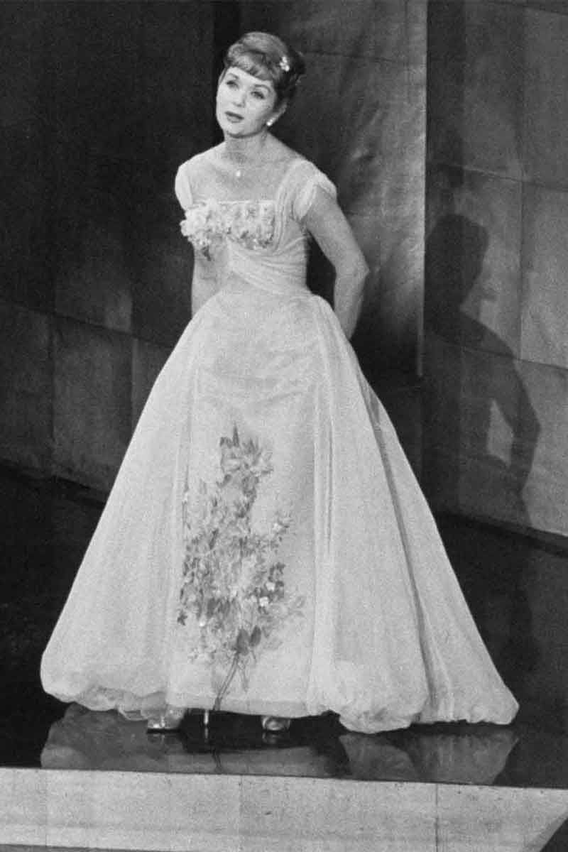 Debbie Reynolds in an elegant ball gown.