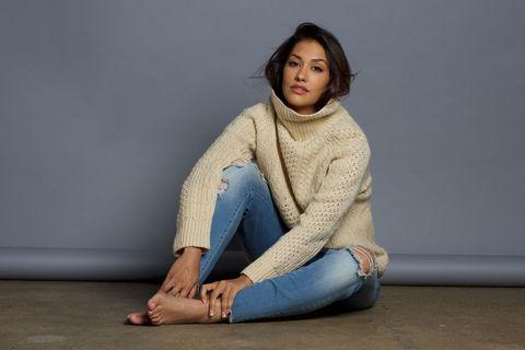 Joint, Sitting, Denim, Floor, Comfort, Wrap, Knee, Sweater, Toe, Street fashion,