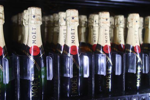 Bottle, Carmine, Glass bottle, Alcohol, Alcoholic beverage, Bottle cap, Collection, Distilled beverage, Label,