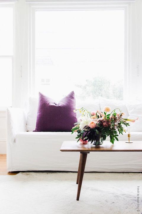 Room, Interior design, Floor, Interior design, Bouquet, Throw pillow, Pillow, Home, Living room, Cut flowers,