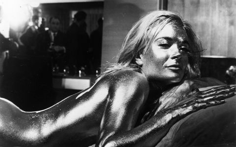English actress Shirley Eaton covered in gold in the James Bond film 'Goldfinger', directed by Guy Hamilton and starring Sean Connery.   (Photo by Keystone/Getty Images)