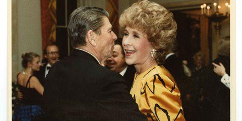 Betsy Bloomingdale dancing with Ronald Reagan