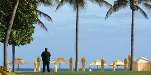 A security agent stands guard at the Mar-a-Lago Club where US President-elect Donald Trump is holding meetings December 30, 2016, in Palm Beach, Florida
