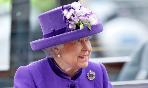 Hat, Purple, Outerwear, Violet, Facial expression, Fashion accessory, Headgear, Costume accessory, Lavender, Costume hat,