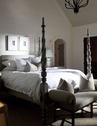 A typically primped and plumped bed in one of the many accommodations.