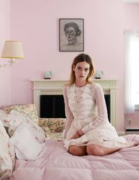 Elizabeth Woolworth, the youngest of Fred Woolworth's eight children, in her bedroom at Fred's House. Valentino dress ($8,500).