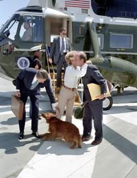 President Reagan greets his dog after arriving by helicopter in 1983.