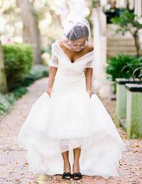 The bride shows off her black satin Badgley Mischka peep-toe shoes.