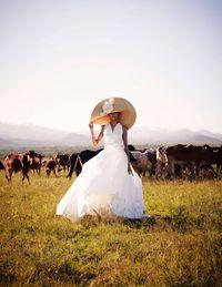 Manuel Mota for Pronovias Gala gown ($4,800)&#x3B; Carolina Herrera hat (price on request).