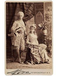 "Cornelius Vanderbilt II as Louis XVI, and Mrs. Vanderbilt (Alice Claypoole Gwynne), as ""Electric Light"" at the Vanderbilt Ball, 1883, photographed by José Maria Mora."