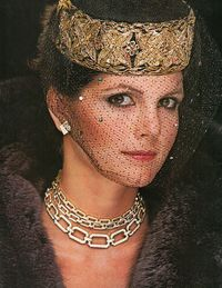 In Town & Country's December 1978 issue, we report on how to ring in the New Year with style in Newport. By channeling Deborah Stoddard Baldwin's look—David Webb earrings and necklaces, Halston for Ben Kahn fur, and Don Kline veil—we can create an equally alluring look for New Year's Eve 2013.