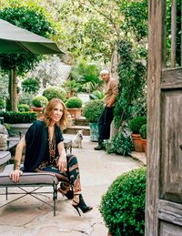 """""""I swear they breed in the night,"""" interior designer Madeline Stuart, an Angeleno since she was three years old, says of the ever-expanding topiary collection at her house in the Outpost section of the Hollywood Hills. Stuart and her husband Steve Oney moved to the area from the flats with Beatrice, their Parson Jack Russell terrier, in 2000. """"I used to garden on Sundays, but I would spend so much time tending to my roses and tomatoes that it became another workday,"""" Stuart says. """"So when we moved here I started this topiary garden that would be impossible for me to tend. I am not Edward Scissorhands."""" Now the garden is the designer's Sunday rest. """"I spend all day on the chaise with a pile of papers and magazines that I have put aside, and I emerge at the end of the day. Steve will ask me what I've read, and I can't remember because I've consumed so many visual calories that I am totally satiated and gorged on information,"""" she continues. """"I think it's the only thing that keeps me from being truly mad and totally bonkers."""" Stuart, a statuesque brunette who has a penchant for vintage caftans, very high heels, and armfuls of bangles, speaks in a rapid-fire staccato. It is difficult to imagine her ever at rest.Since 1994, Stuart has restored houses designed by such architectural icons as Gerard Colcord, Cedric Gibbons, Sylvanus Marston, and Paul Williams. Her client roster includes Larry David, art collectors David and Susan Gersh, 20th Century Fox Television chairman Gary Newman and his wife Jeanne, movie producer John Goldwyn, and hotelier Jeff Klein. She creates her own furniture and lighting lines, which are available at eight showrooms across the country, and she designed the green room for the 2013 Academy Awards.""""The work for my clients is often very clear: stream-lined modern, Spanish colonial. My own house is very different. It's not a collection of noteworthy elements but a personal reflection,"""" she says. """"It's the stuff I drag in, the bits and bobs I've coll"""