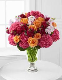We love the pops of orange and lavender in this offering. Also, who doesn't love bright pink hydrangeas?ftd.com