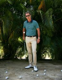 """The Gaelic word for """"club"""", Maide is only in its second year, but thanks to parent company, Bonobos, is already a major player in the contemporary golf look. The line draws its inspiration from the golden age of golf – the 50s, 60s, and 70s. Not entirely turning its back on the performance aspect of the sport, Maide aims to marry form and style. Director Ian Verlandi has designed a trimmer fit that is stylish while still being functional. Verlandi explains: """"Our apparel is more street-wear but has the performance aspect needed to play golf. We want to blur the line between on-course and off-course style for golfers to make wearing Maide as easy as possible."""" Along with classic subtle tones, the brand also deftly uses bold colors – green, purple and red – and vintage patterns like floral or the kingpin pattern golf/bowling shirt so that you can be fashion-forward while still adhering to the club's dress code."""