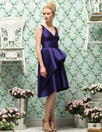How stunning is this shade of deep amethyst? We love the neckline and flattering full skirt as well.dessy.com